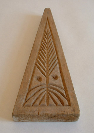 One of the sides of a maple syrup sugar mold with design. Photo: DP