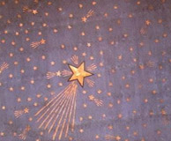 Star stencil depicting Halley's Comet, revealed under tin sheeting on the apse ceiling. Photo: DC