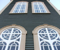 Windows and exterior of the former church restored to original colors. Photo: DP